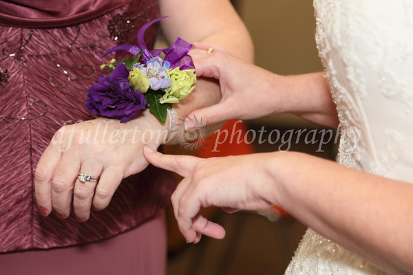 Rebecca made the final touches to her mother's corsage before the wedding on 5-7-11.