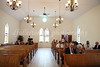 The interior of Hope Chapel was just as one would expect a classic white chapel to be; hardwood floor and pews with a few simple yet elegant stained glass windows.