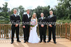 Michelle and all the groomsmen take time for a picture.
