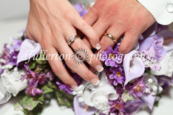 The rings and bouquets make for a warm and thoughtful photo.