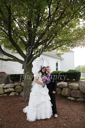 Congratulations Erin and Don!  May your love for each other richly blossom as did that tree behind you.