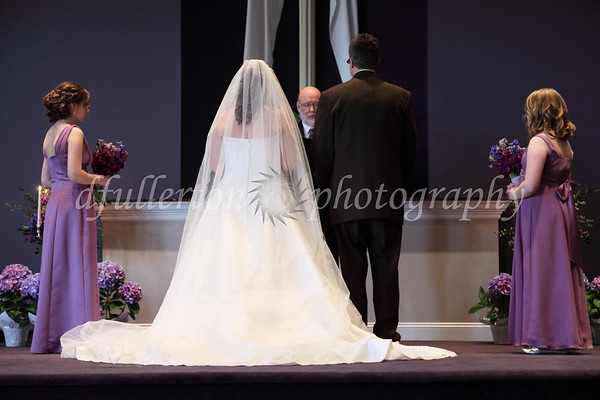 Rebecca and Marc standing before the altar during their ceremony.