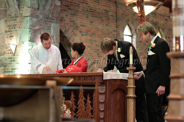 The signing of the marriage contract was done at the altar.