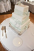 Wedding cakes are always a treat - both figuratively and literally!  This one was decorated quite nicely as well, with all the ribbons made from frosting.