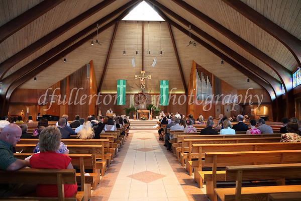 The fairly large church was moderately filled with observants for Katharina and Anthony's wedding on 6-25-11.