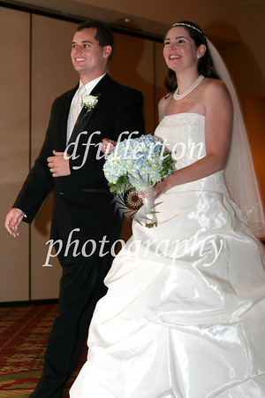 Matt and Lorena strolling down the aisle during their wedding dinner, 9-6-08.