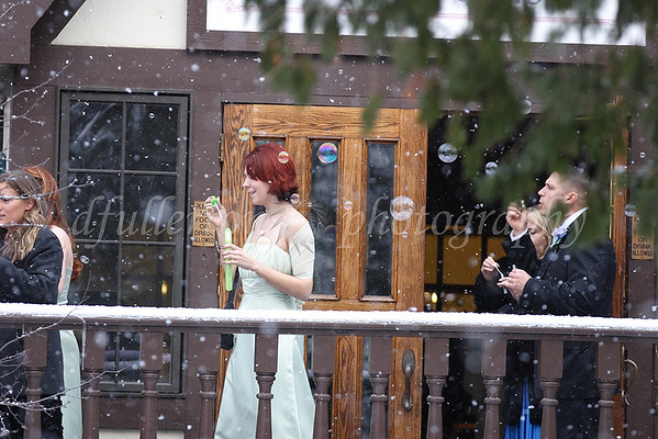 We were unexpectedly greeted with both bubbles and snow as the newlyweds exited from the chapel!