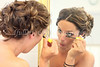 Here one of Julie's Bridesmaids put on her finishing touches for the day.