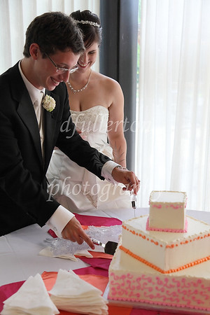 Another wedding...another cake met the knife!  Inside, cake and berry filling.