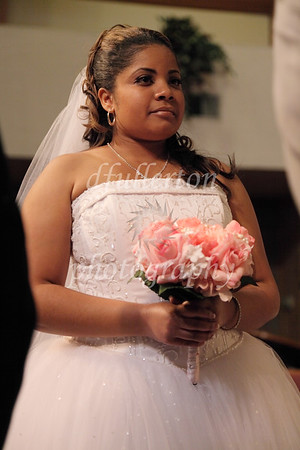 Brittney waits patiently as the Reverend shares his insight to the couple.  8-14-10
