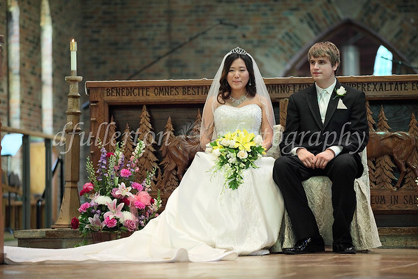 Ahra and Jake at the alter during the opening prayers.
