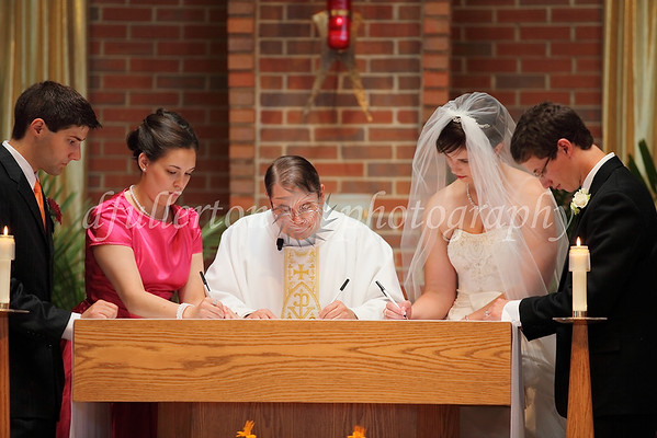 The Marriage License was signed right at the altar before the final announcement of Husband and Wife.