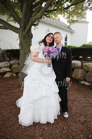 A large tree outdoors lent a great and cool location for Erin and Don to pose under.