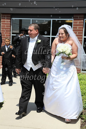 Michelle and Jeff suddenly walked into walls of bubbles upon exiting the church.