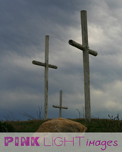 The three crosses - one of them is on a rock.