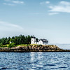 Lighthouse On the Coast of Maine's Rocky Shores