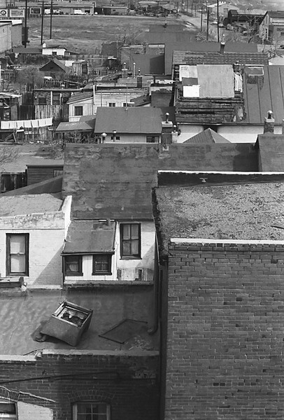 1950s CO Chair on roof in Denvers Colfax area