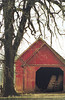 1981 IA Winterset Red outbuilding with tractor tires