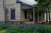 2004/04 Flowers Bluebonnets and stone house in Fredericksburg