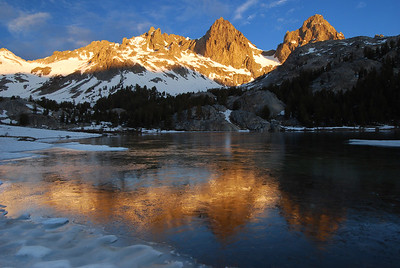Sunrise Banner Peak and Mount Ritter Thawing Lake Ediza.  Sierra Nevada Range, California.