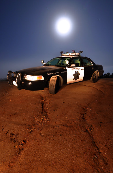 -1ST PLACE WINNER AND PUBLISHED<br /> San Diego Sheriff Association Magazine<br /> Cover Photograph Competition 2010<br /> <br /> Patrol Vehicle and Moon<br /> Copyright © 2010<br /> All rights reserved.