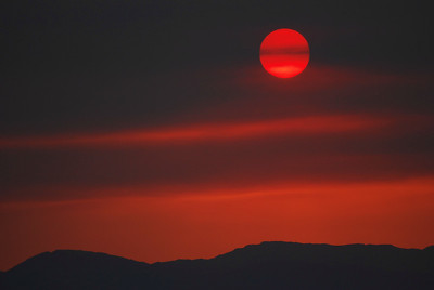 Sunrise Over the Inyos (Through Wildfire Smoke) Olancha, California.  Copyright © 2009 All rights reserved.