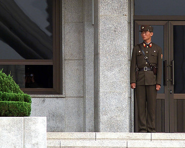 North Korean side, Pan Man Jan, DMZ (de-militarized zone between North and South Korea). Notice the window on the left, person with binoculars.