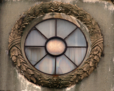 This is a photo of a window on an old grand stand of a horse race track in Yokohama Japan.