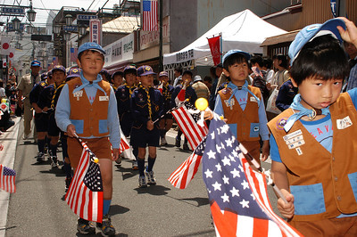 SHIMODA Japan (May 15, 2004) -- Local scout troups march through the streets of Shimoda on May 15, in honor of the 65th Black Ship Festival.  USS Coronado (AGF 11) and USS Cowpens (CG 63) participated in the festival. The festival promotes the theme of peaceful relations between the Japanese and American people, and commemorates the 1854 landing of Commodore Matthew Perry and the signing of the Japanese-American treaty of trade and amity at Shimoda.  This year's festival commemorates the 150th anniversary of that landing.   by Winston C. Pitman