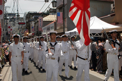 SHIMODA, Japan (May 15, 2004) – Japanese Maratime Self Defense force Navy personnel march through the streets of Shimoda on May 15, in honor of the 65th Black Ship Festival.  USS Coronado (AGF 11) and USS Cowpens (CG 63) participated in the festival. The festival promotes the theme of peaceful relations between the Japanese and American people, and commemorates the 1854 landing of Commodore Matthew Perry and the signing of the Japanese-American treaty of trade and amity at Shimoda.  This year's festival commemorates the 150th anniversary of that landing.  by Winston C. Pitman