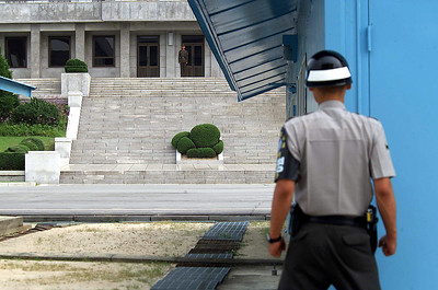 PAN MAN JUN, South Korea (August 21, 2002) -- Joint Security Area, Republic of Korea Guard, Faces off with his counterpart across the de-militarized zone (DMZ) in the Democratic Peoples Republic of Korea.    By  Winston C. Pitman