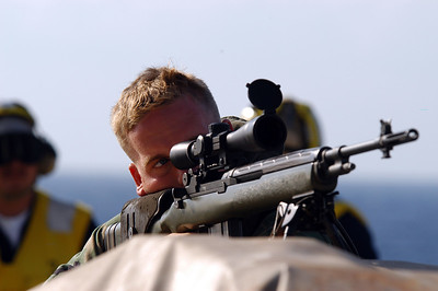 ABOARD USS BLUE RIDGE AT SEA (Oct. 18, 2003) --  Lance Cpl. Dale W. Wood, attached to 2nd FAST Co., 7th Platoon 1st squad, native of Greenwood, Miss., looks through his sniper scope for bad guys during a vessel boarding search and seizure training scenario aboard USS Blue Ridge (LCC 19). Blue Ridge is currently underway for a regularly scheduled deployment.  (U.S. Navy photo by Photographer's Mate 1st Class (AW) Winston C. Pitman)