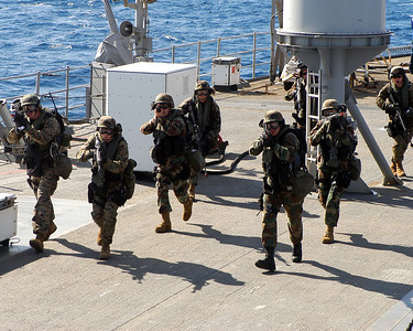 ABOARD USS BLUE RIDGE IN AT SEA (Oct. 25, 2003) -- Marines from 2nd FAST Co., 7th Platoon, 1st squad, run from the flight deck to the super structure of USS Blue Ridge (LCC 19) during a visit, board, search and seizure training scenario. Blue Ridge is currently under way for a regularly scheduled deployment.   (U.S. Navy photo by Photographer's Mate 1st Class (AW) Winston C. Pitman)