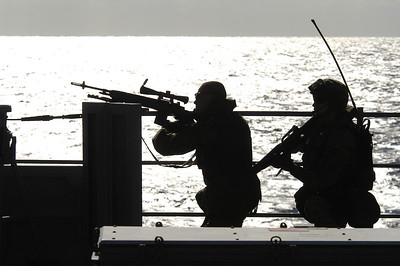 ABOARD USS BLUE RIDGE IN AT SEA (Oct. 25, 2003) -- Two Marines from 2nd FAST Co., 7th Platoon, 1st squad, provide sniper cover for their team during a visit, board, search and seizure training scenario aboard USS Blue Ridge (LCC 19). Blue Ridge is currently under way for a regularly scheduled deployment.   (U.S. Navy photo by Photographer's Mate 1st Class (AW) Winston C. Pitman)