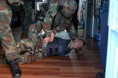 ABOARD USS BLUE RIDGE IN AT SEA (Oct. 25, 2003) -- Lance Cpl. Jeremy Baker, native of Mesa, Ariz., removes a weapon from the belt of Cpl. Curtis Cramsey, of Liberty, Ill., playing the part of a suspected terrorist in the pilothouse. 2nd FAST Co., 7th Platoon, 1st squad, practiced a visit, board, search and seizure training scenario aboard USS Blue Ridge (LCC 19) Oct. 25. Blue Ridge is currently under way for a regularly scheduled deployment.   (U.S. Navy photo by Photographer's Mate 1st Class (AW) Winston C. Pitman)