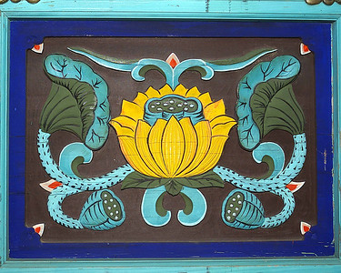 A passion flower adorns the side of a Buddhist temple in South Korea.