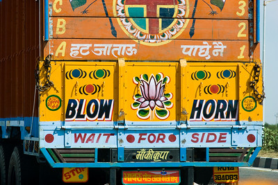 Instructions for passing are painted on most large vehicles. National Highway 8, Rajasthan, India  |  2007
