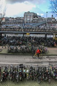 Bicycle parking 'spaces' near Amsterdam Centraal: Bike flat: 2,700 Bike platform: 1,120 Bike boat: 370 Supervised storage: 1,860 Racks (including in District of Noord): 2,750 Total: 7,800