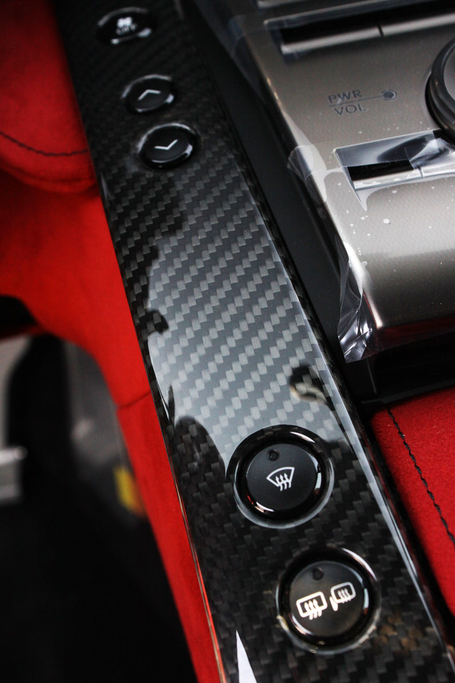 The black is carbon fiber, and the red is suede.