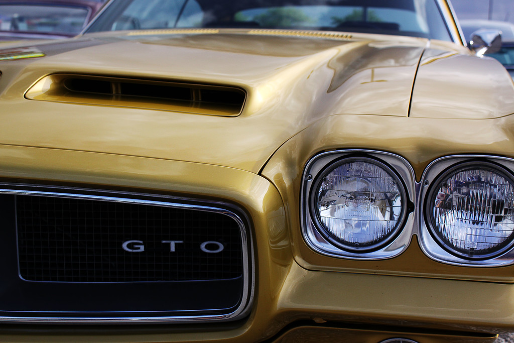 The front end of a 1972 Pontiac GTO reveals beautiful curves, the large grill and Ram Air hood scoops.