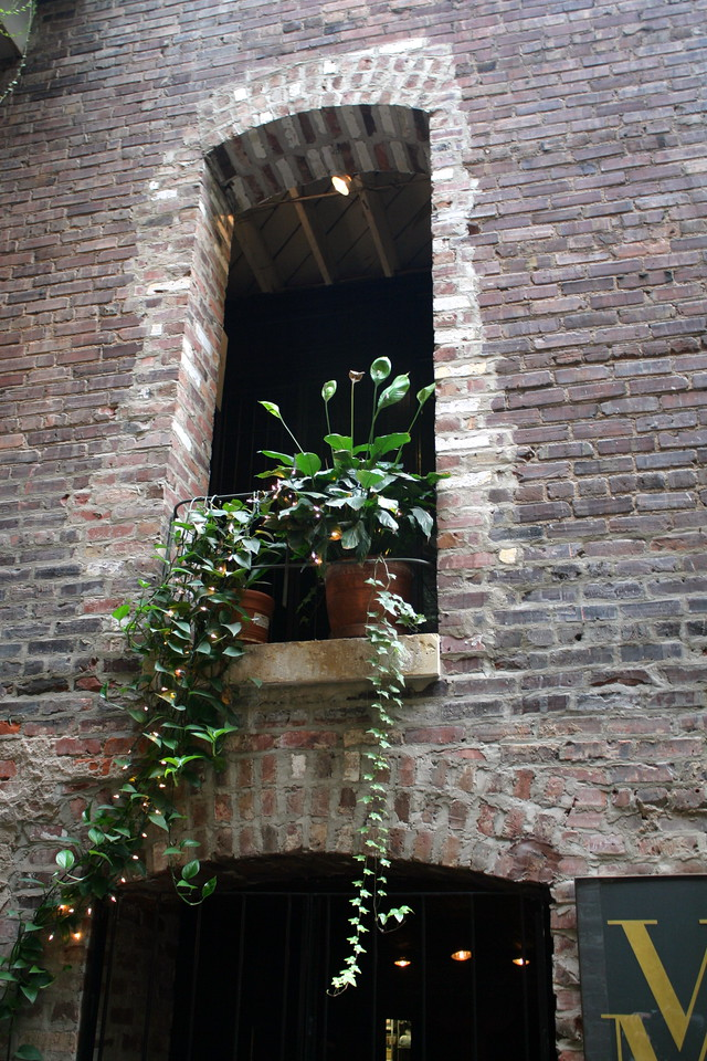 View of one of the second-story windows inside of the Old Market passageway in downtown Omaha.