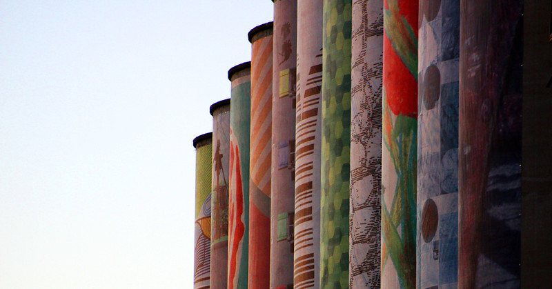 Beautiful murals, given by a nonprofit agency, adorn the west side of the abandoned grain silos.