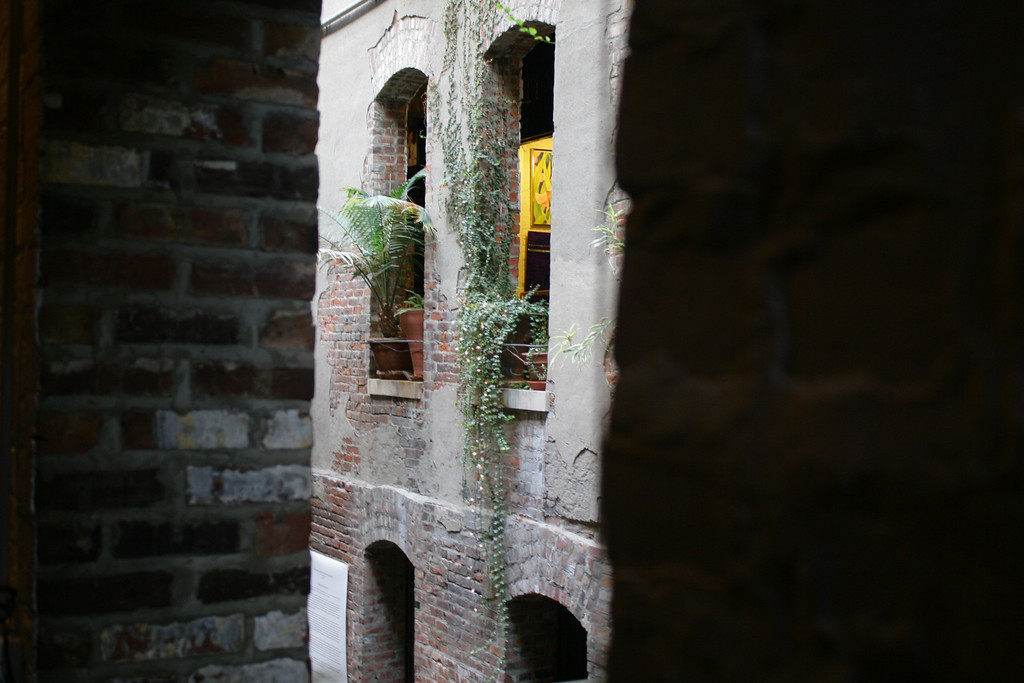 View of one second-story window through another in the Old Market passageway in downtown Omaha.