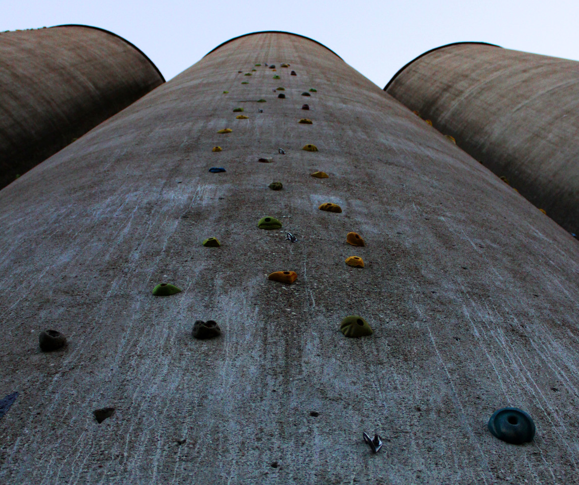 The east side of the abandoned grain silos have rock climbing challenges of varying heights. This one only goes halfway to the top of the 120 foot tall silos.