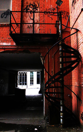 An old wrought iron stairwell with the offices of Trinity Episcopal Cathedral at the end of the hallway at 18th and Capital Streets in downtown Omaha, Nebraska.