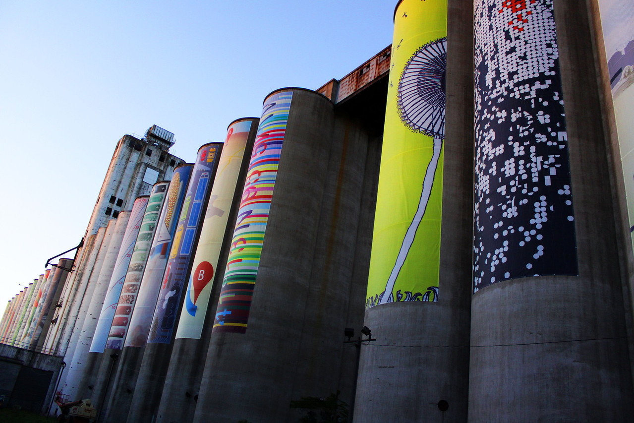 The front of the abandoned grain silos off 36th Street and I-80. A nonprofit has hung various artwork pieces on the west side.