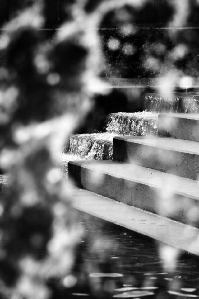 View of one waterfall through another at the Gene Leahy Mall in downtown Omaha, Nebraska.