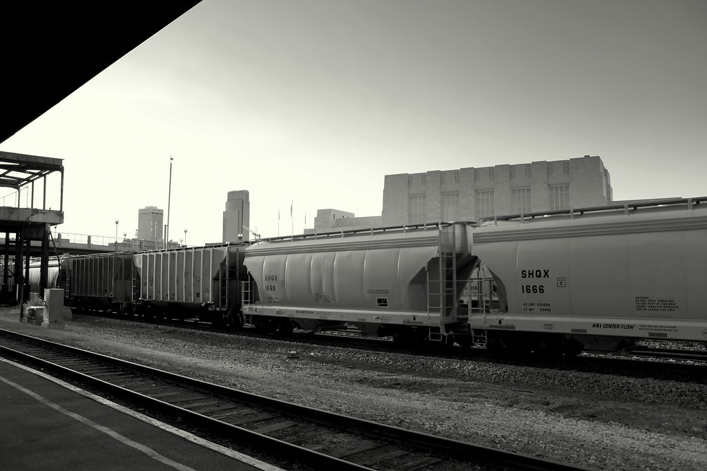 A train passes between the old Burlington Northern building and the Durham Western Heritage Museum (behind). From left, the Woodmen Tower and First National Tower can be seen in the background.