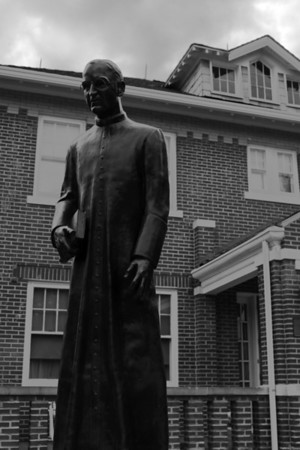 A statue of Father Flannigan in front of the house he lived in at Boys Town in OMaha, Nebraska