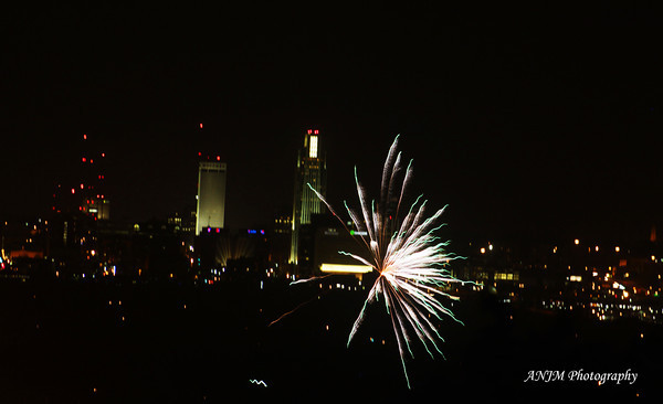 By pure chance, I happen to take this photo of a random firework exploding over Council Bluffs, IA in front of the Omaha skyline. I took this while waiting for the July 3rd fireworks show at TD Ameritrade Park in Omaha to begin.